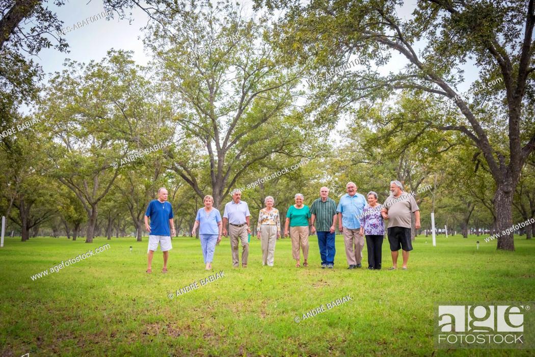 Stock Photo: USA, Texas, Group of senior citizens in park.