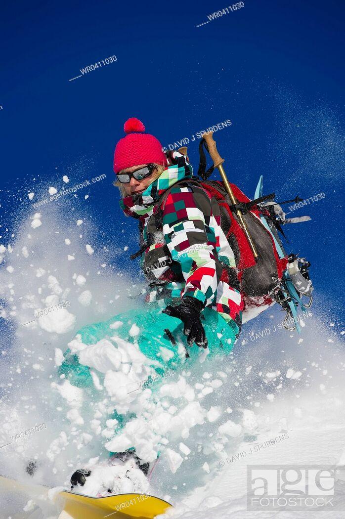 Stock Photo: A snowboarder explodes through fresh powder snow.