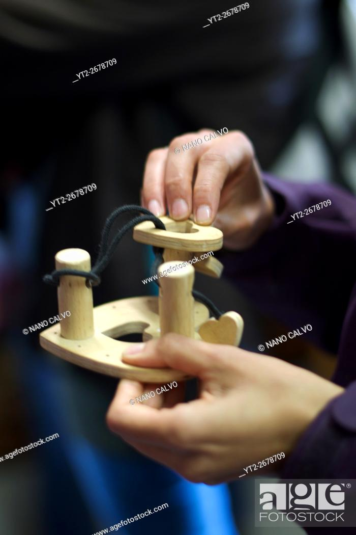 Stock Photo: Wooden puzzle games. Traditional costumes and folk traditions at Easter Festival in Hollók?, UNESCO World Heritage-listed village in the Cserhát Hills of the.