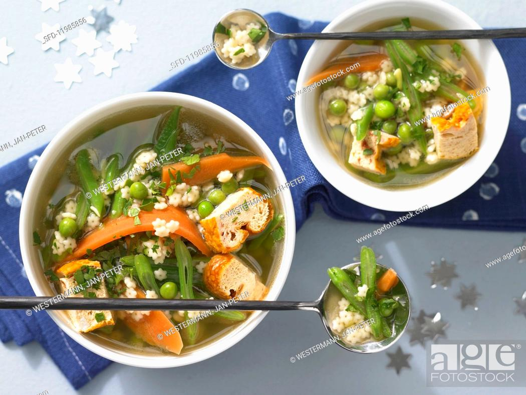 Stock Photo: Soup with star-shaped mini pasta, custard royale and vegetables.