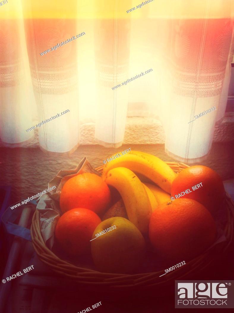 Stock Photo: Fruiterer under the window.