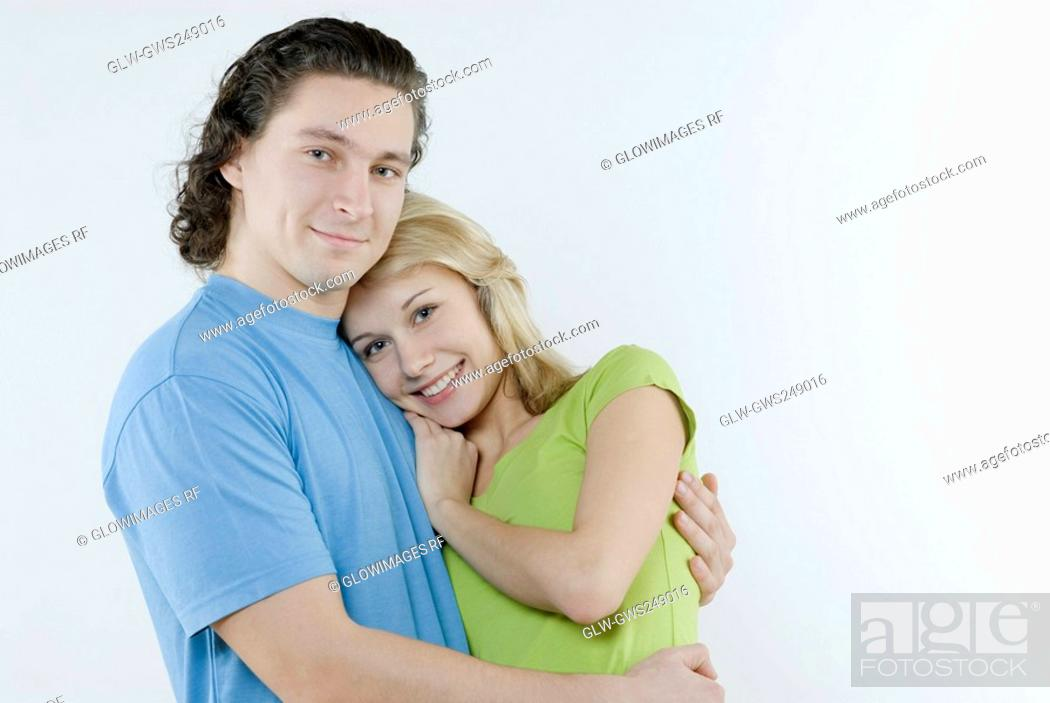 Stock Photo: Portrait of a young couple embracing each other.