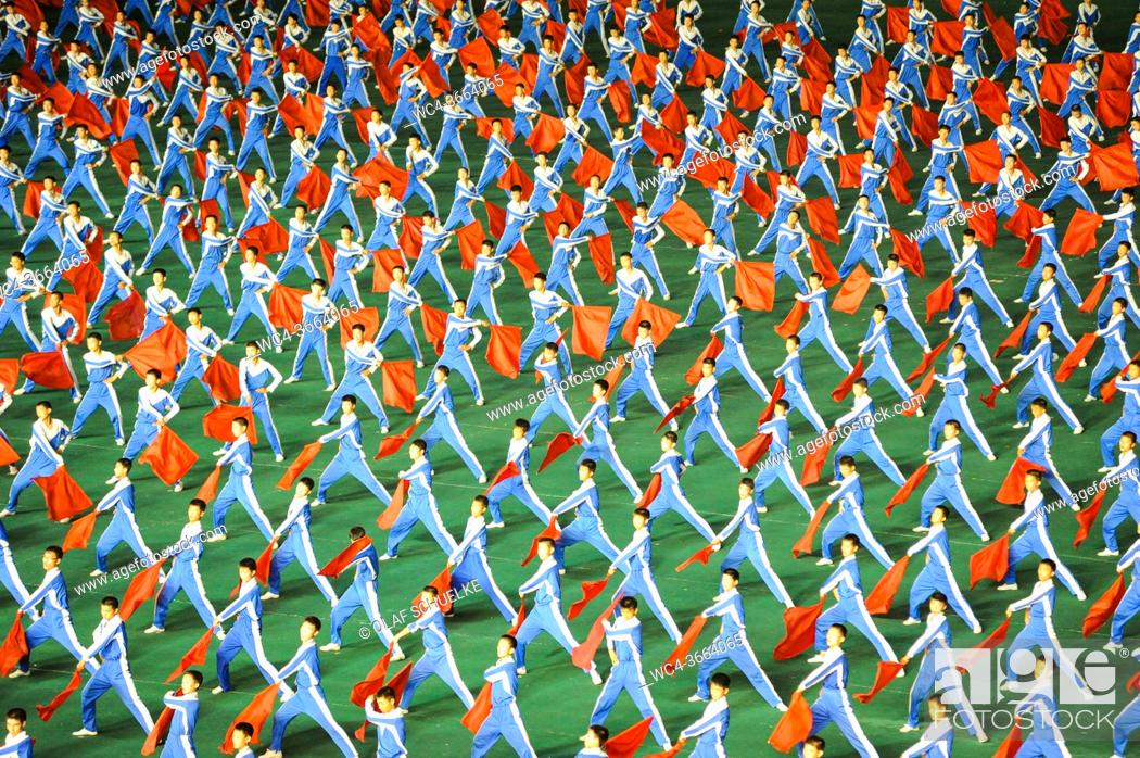 Stock Photo: Pyongyang, North Korea, Asia - Mass choreography and Artistic Performance with dancers and acrobats at the May Day Stadium during the Arirang Mass Games.