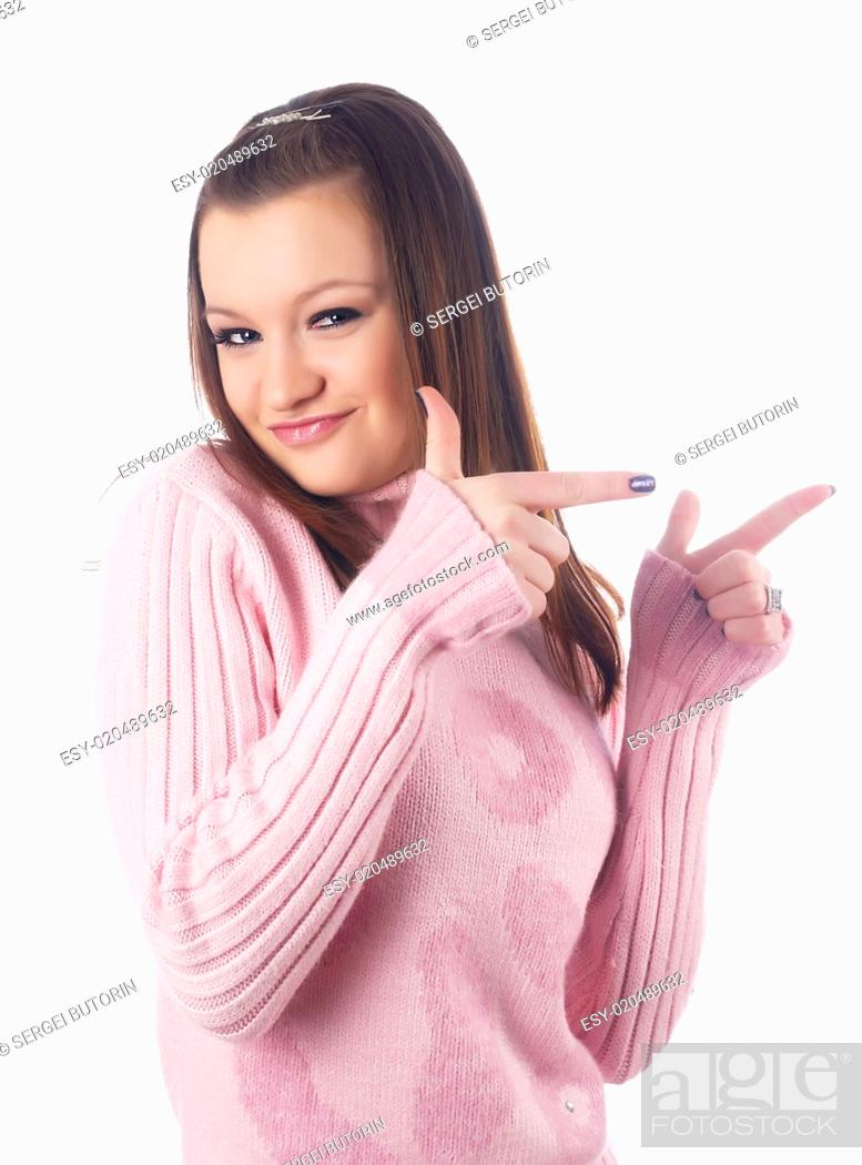 Stock Photo: Pretty girl pointing at side.