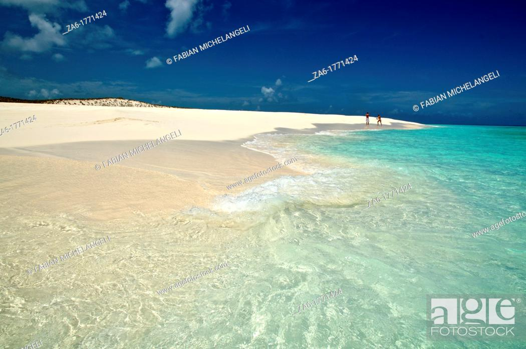 Stock Photo: People walking in a desolate and pristine white sand beach  Cayo de Agua, Los Roques National Park, Venezuela.