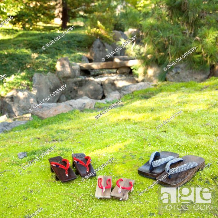 Stock Photo: Japanese sandals on grass in garden.