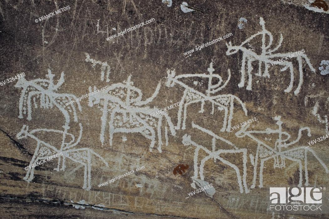 Stock Photo: Petroglyphs degraded by graffiti at Langar ( Wakhan valley, Tajikistan). They are representing horsemen.