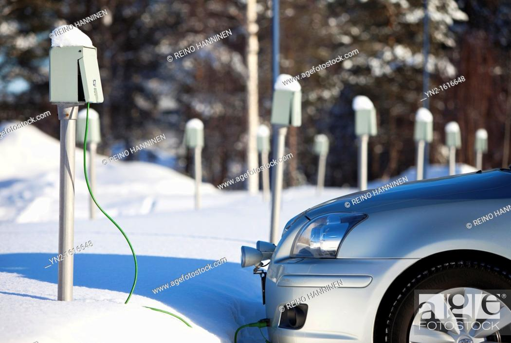 Stock Photo: Outdoor power outlets used to deliver electricity to electric car motor heater. Oulu, Finland.