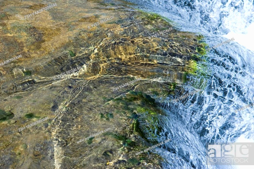 Stock Photo: Water flowing over rock, close-up.