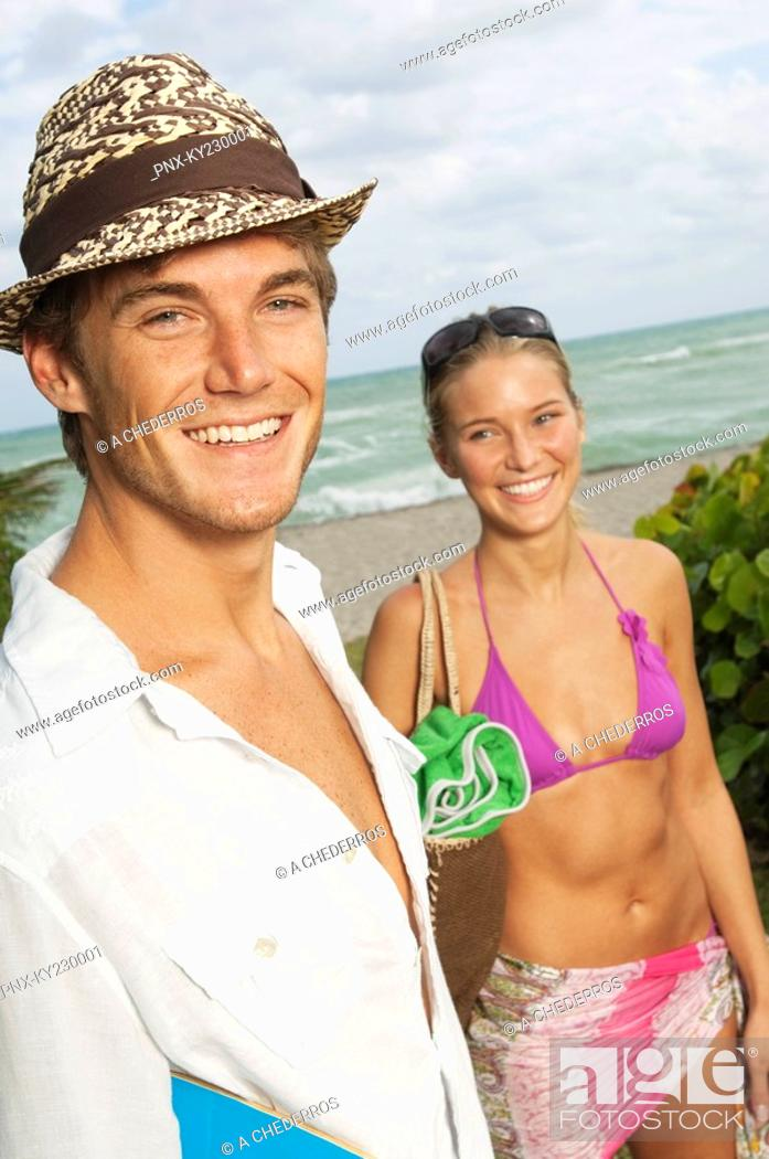 Stock Photo: Portrait of a man smiling with his girlfriend.