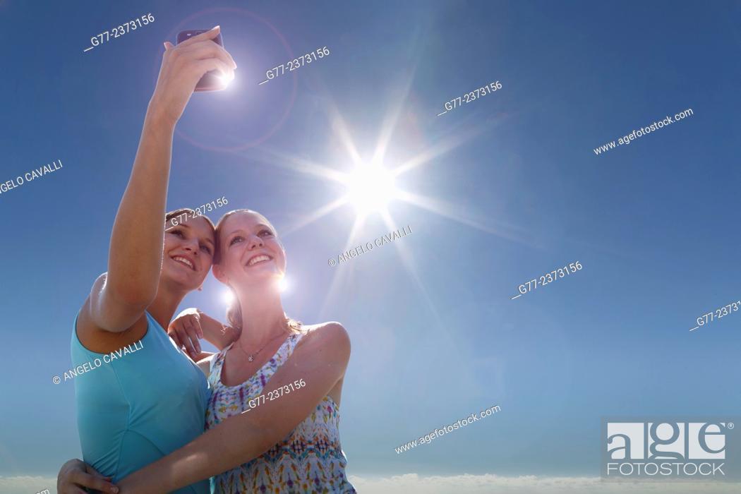 Stock Photo: Two young women taking selfie. Miami Beach, Florida, Usa.