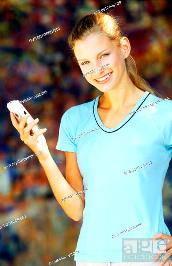 Stock Photo: Young woman holding a mobile phone.