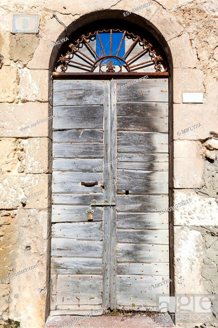 Stock Photo: old vintage wooden door in a house on the island of Sardinia, Italy.