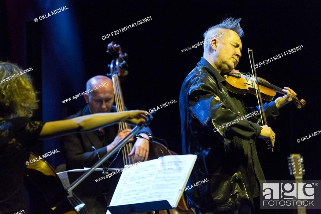 English violinist and violist Nigel Kennedy (right) performs during