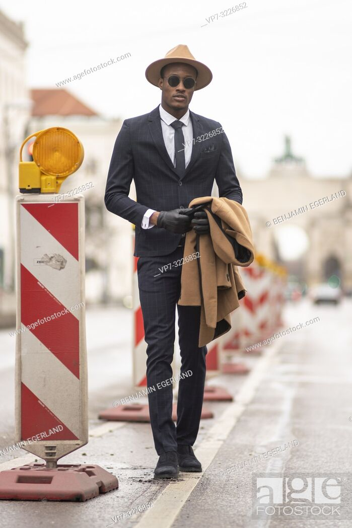 Stock Photo: Fashionable man walking on the street. Munich, Germany.