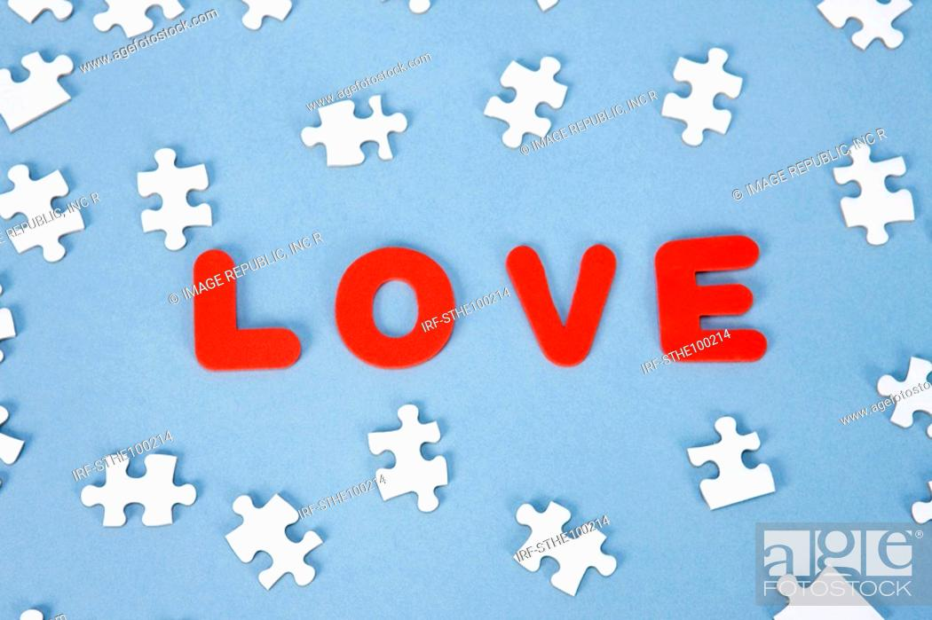 Stock Photo: pieces of puzzle and LOVE.