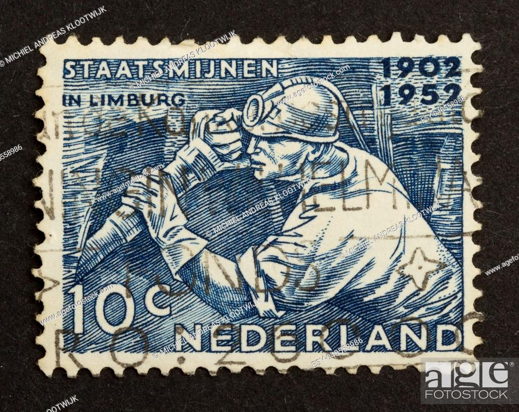 Stock Photo: HOLLAND - CIRCA 1950: Stamp printed in the Netherlands shows a miner in action, circa 1950.