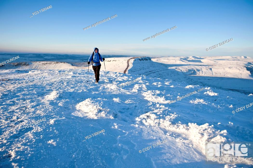 Stock Photo: Single female hiker of Snow covered summit of Pen Y Fan, Brecon Beacons national park, Wales.