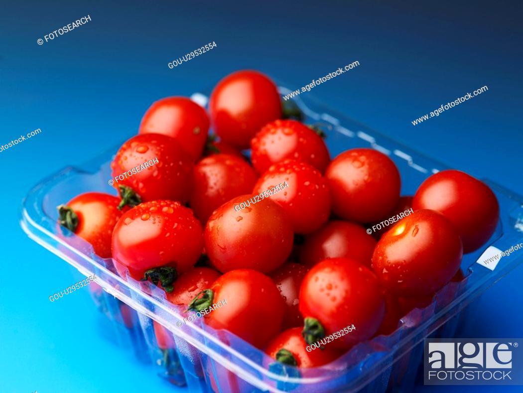 Stock Photo: cherry tomato, plastic container, fruit, plants, plant, plastic fruit container.