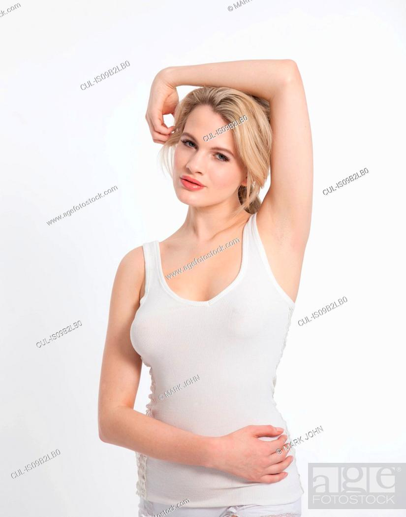 Stock Photo: Studio portrait of beautiful blond young woman in vest.
