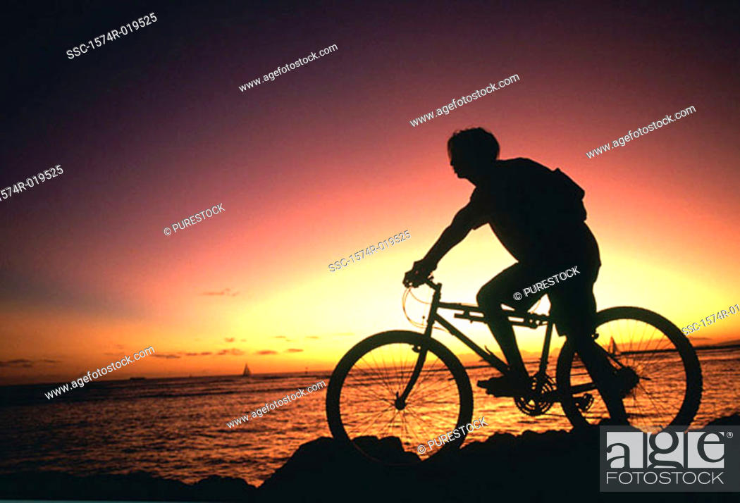 Stock Photo: Person admiring sunset on mountain bike.
