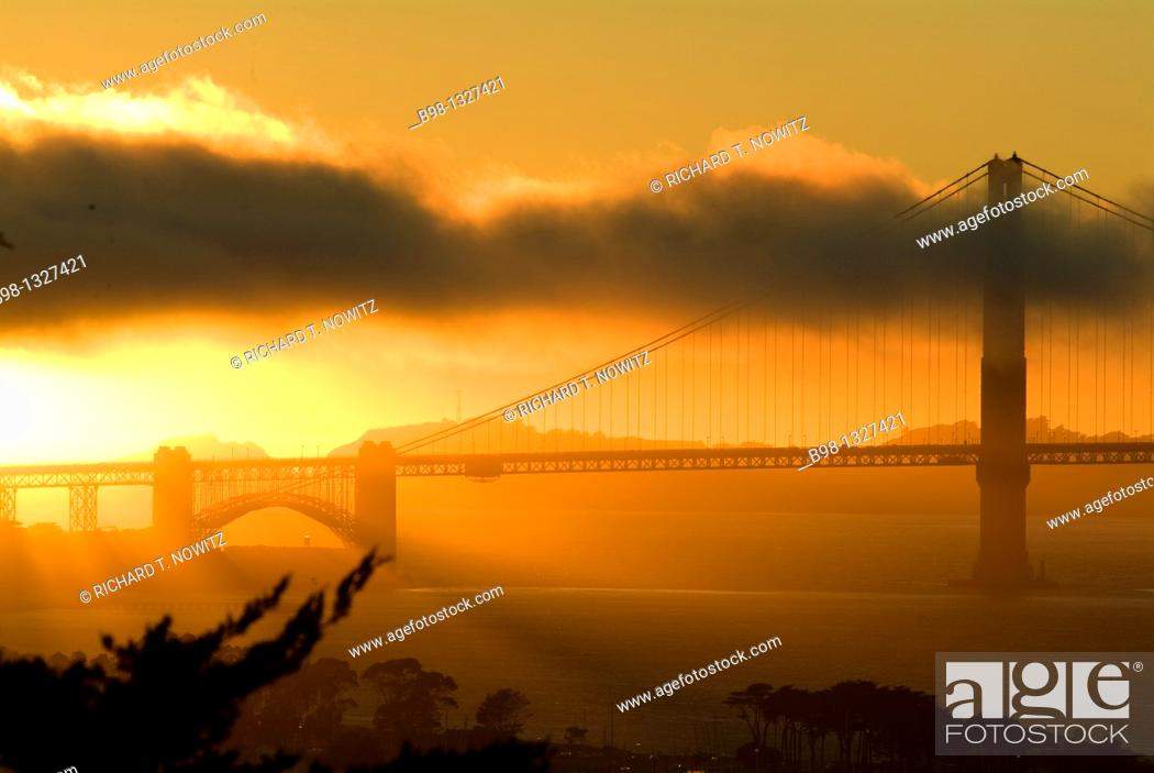 Stock Photo: Golden Gate Bridge at sunset as seen from Russian Hill.