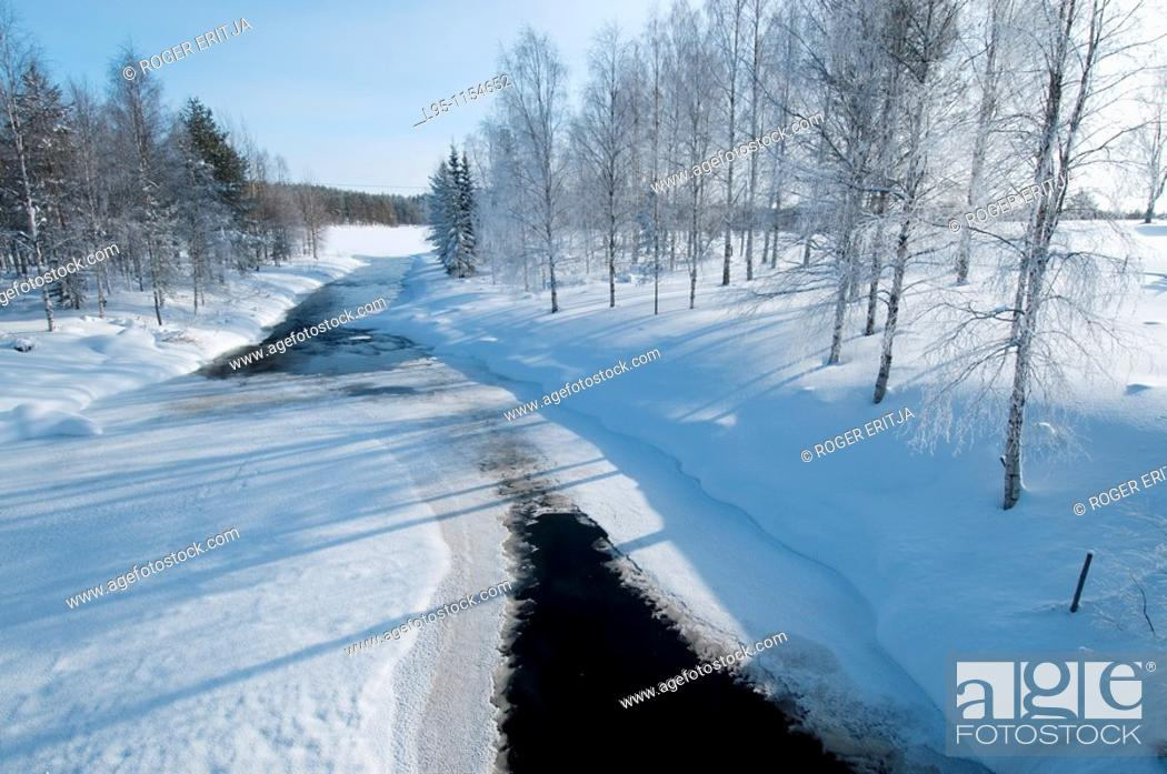 Stock Photo: Frozen river in the surroundings of Kuhmo Finland, in February.