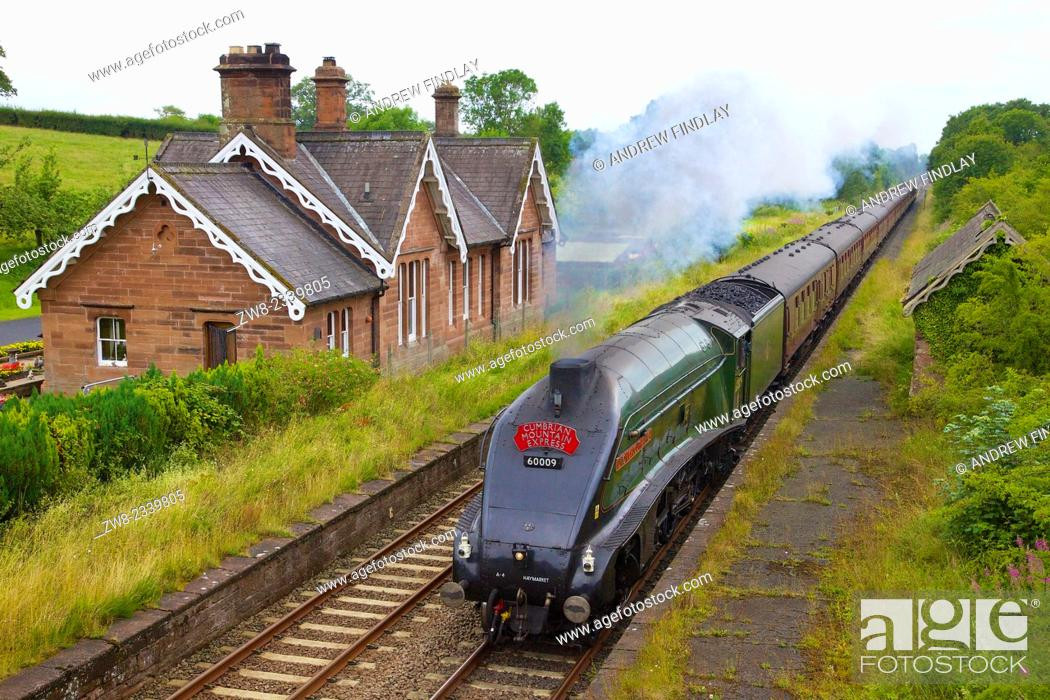 Stock Photo: LNER Class A4 60009 Union of South Africa steam train passing Cumwhinton Station Cumbria Settle to Carlisle Railway Line England UK.