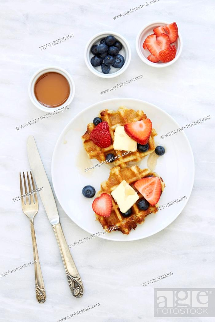 Stock Photo: Overhead view of waffles with strawberries and blueberries.