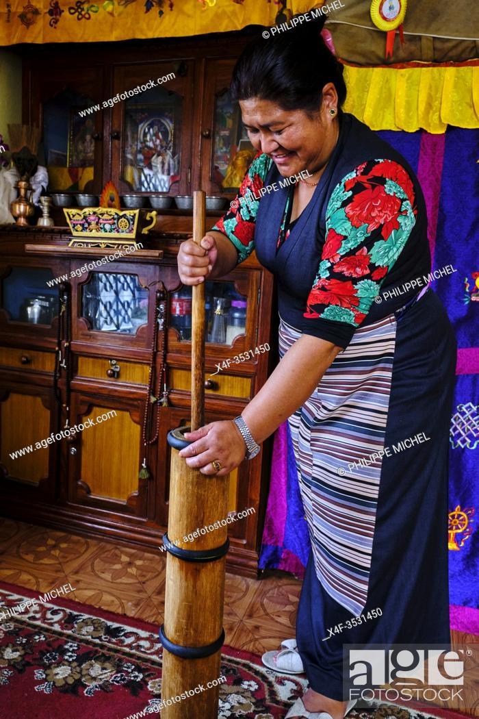 Stock Photo: Nepal, Kathmandu valley, sherpa woman making traditional tibetan tea.