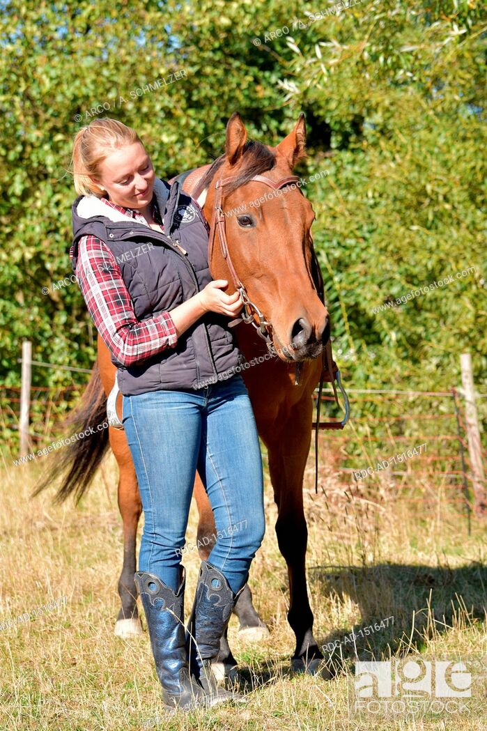 Stock Photo: Young Woman and American Quarter Horse, bay, western horse, gelding.