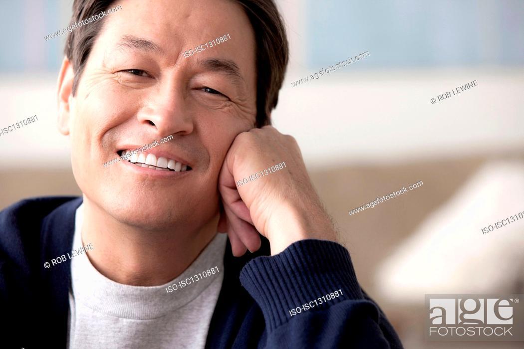Stock Photo: Portrait of mature man smiling.