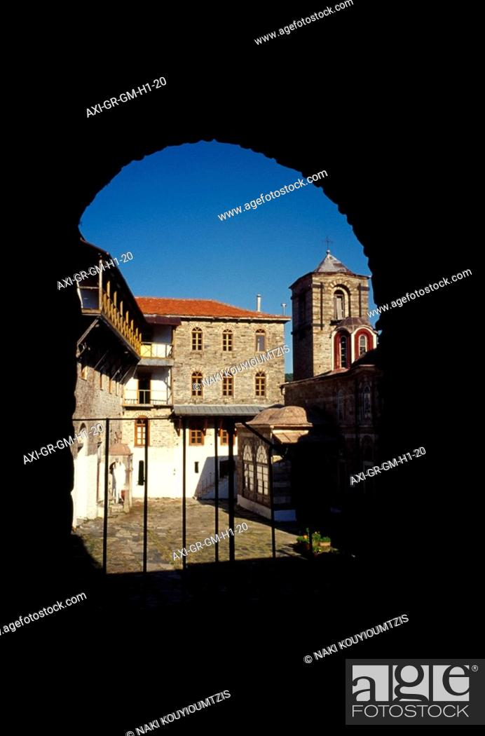 Stock Photo: Sunlit courtyard through arch.