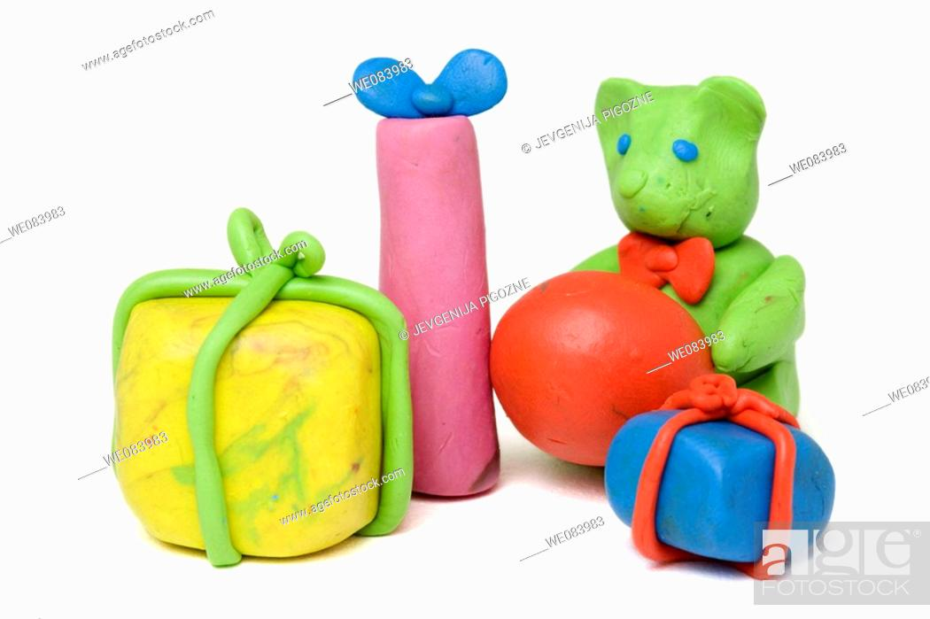 Stock Photo: Plasticine figurines. Presents.