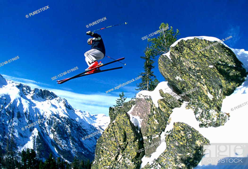 Stock Photo: Low angle view of a man skiing.