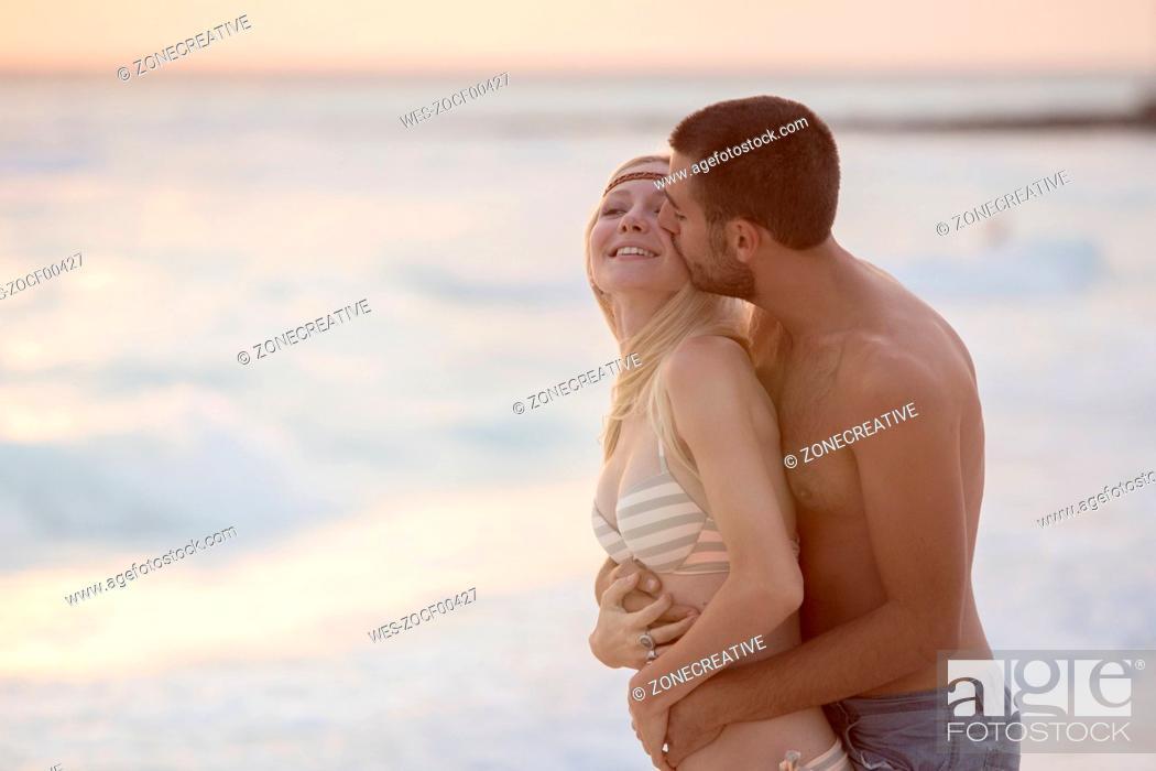 Stock Photo: Romantic couple kissing on the beach.