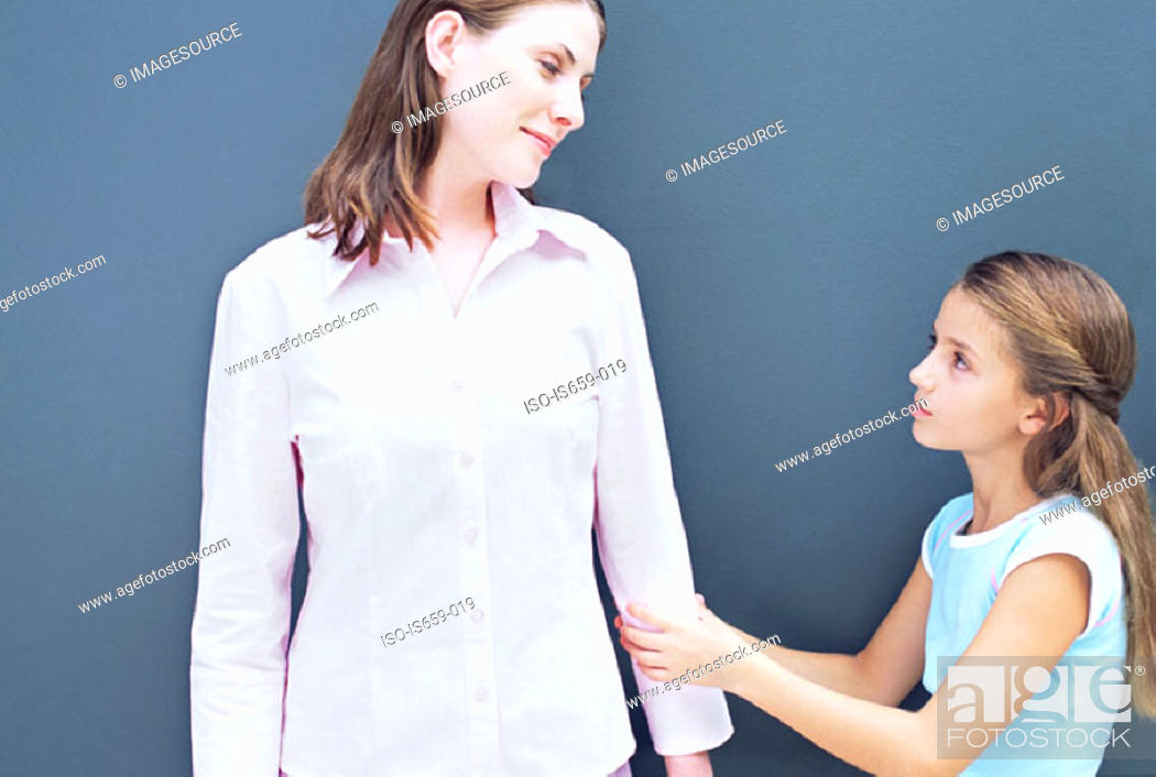 Stock Photo: Girl pulling on mother's arm.