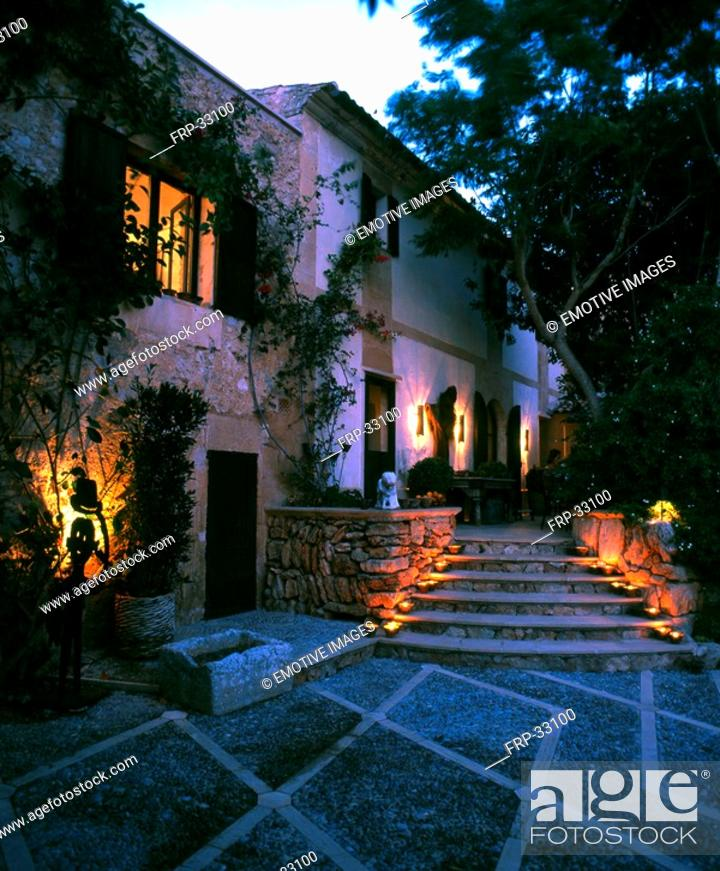 Stock Photo: Garden and stairs with candlelight.