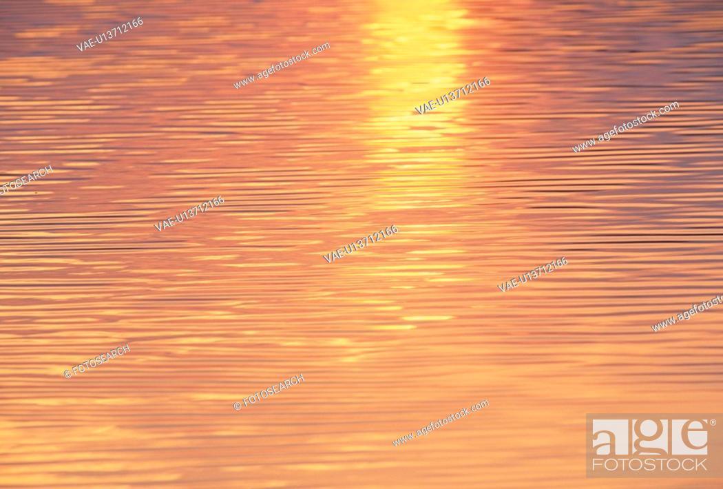Stock Photo: Setting Sun Reflected On The Ocean.