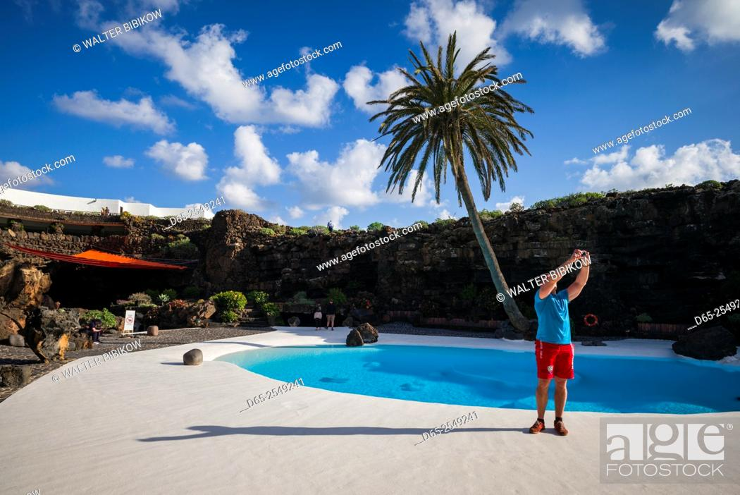 Stock Photo: Spain, Canary Islands, Lanzarote, Jameos del Agua, complex inside old lava tube, designed by Cesar Manrique, exterior pool.