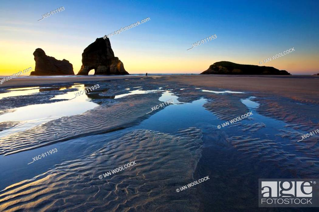 Stock Photo: Rippled Sand and rock formations at Wharariki Beach, Nelson, North Island, New Zealand.