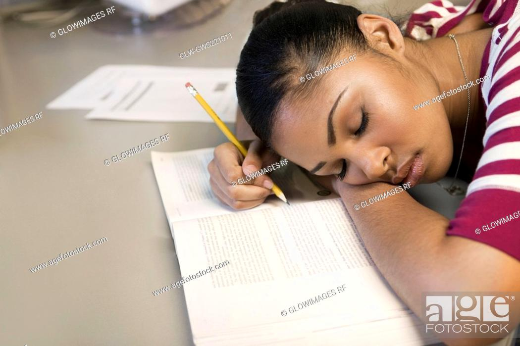 Stock Photo: Close-up of a young man napping on a book.