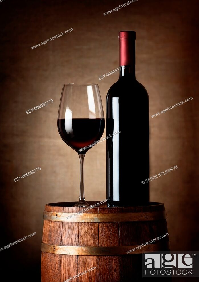 Stock Photo: Wine standing on a barrel on a background of a canvas.