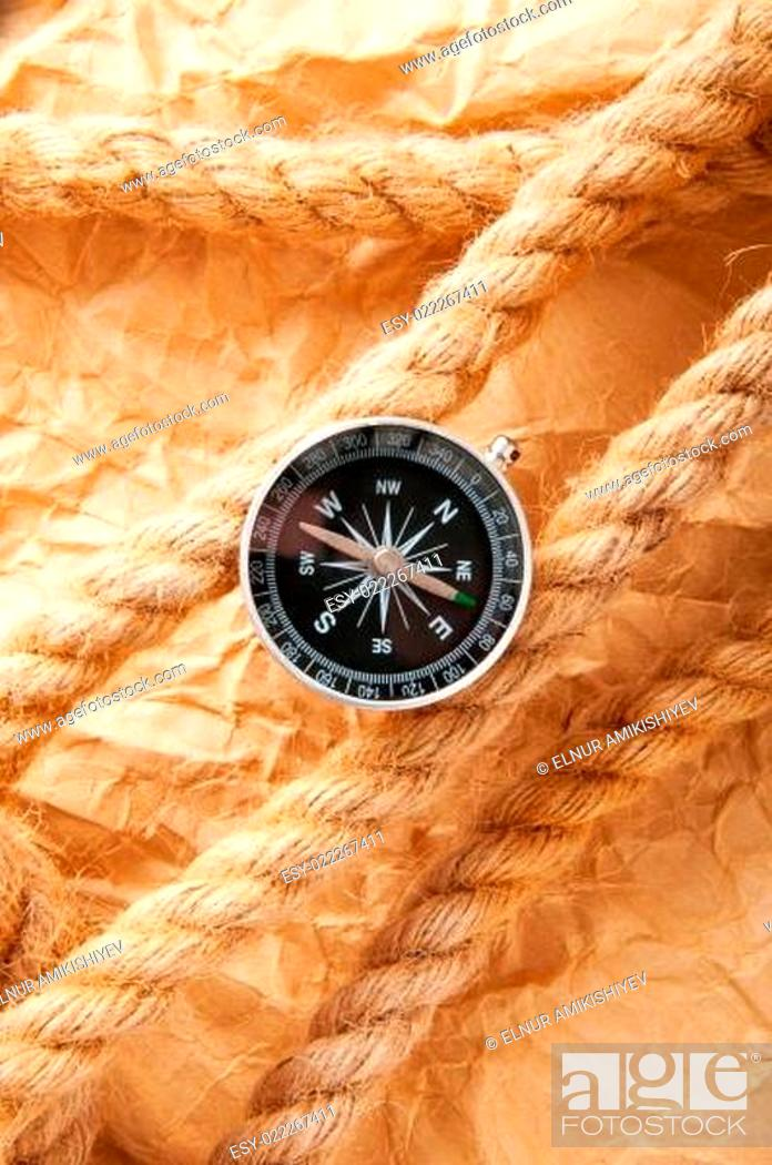 Imagen: Compass and rope in travel and adventure concept.