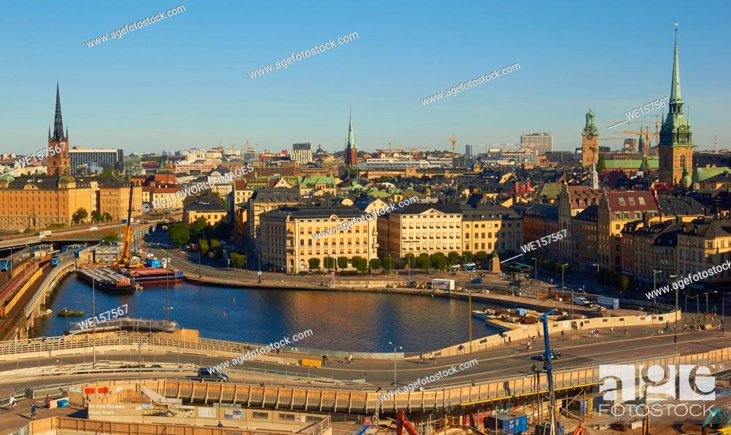 Stock Photo: Cityscape with island of Gamla Stan (old town) and on the skyline to the left spire of Riddarholmskyrkan church on Riddarholmen island, Stockholm, Sweden.