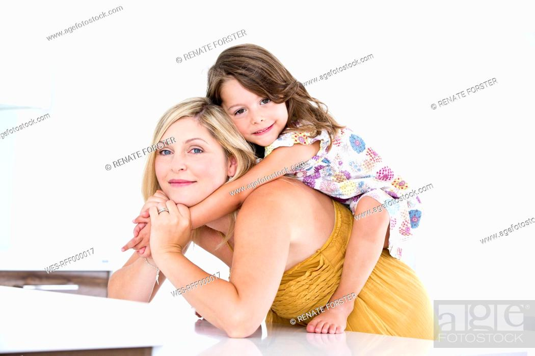 Stock Photo: Germany, Mother and daughter having fun, smiling.