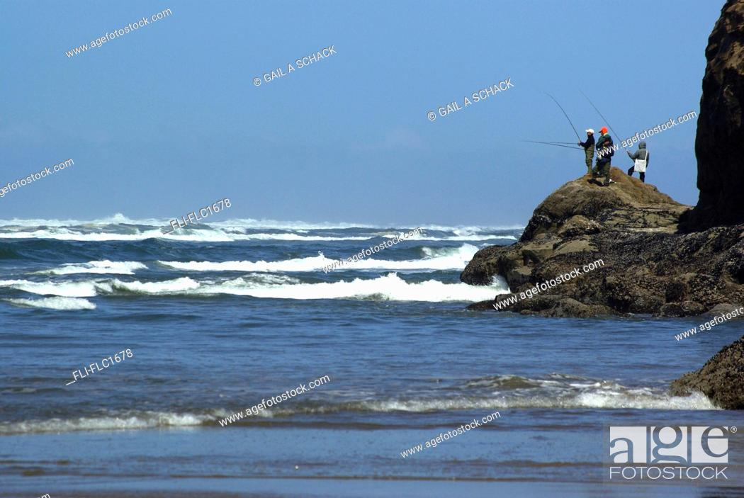Stock Photo: Four men fishing on the shore of the Pacific Ocean off rocky bluff in Hug Cove near Cannon Beach, Oregon, USA.