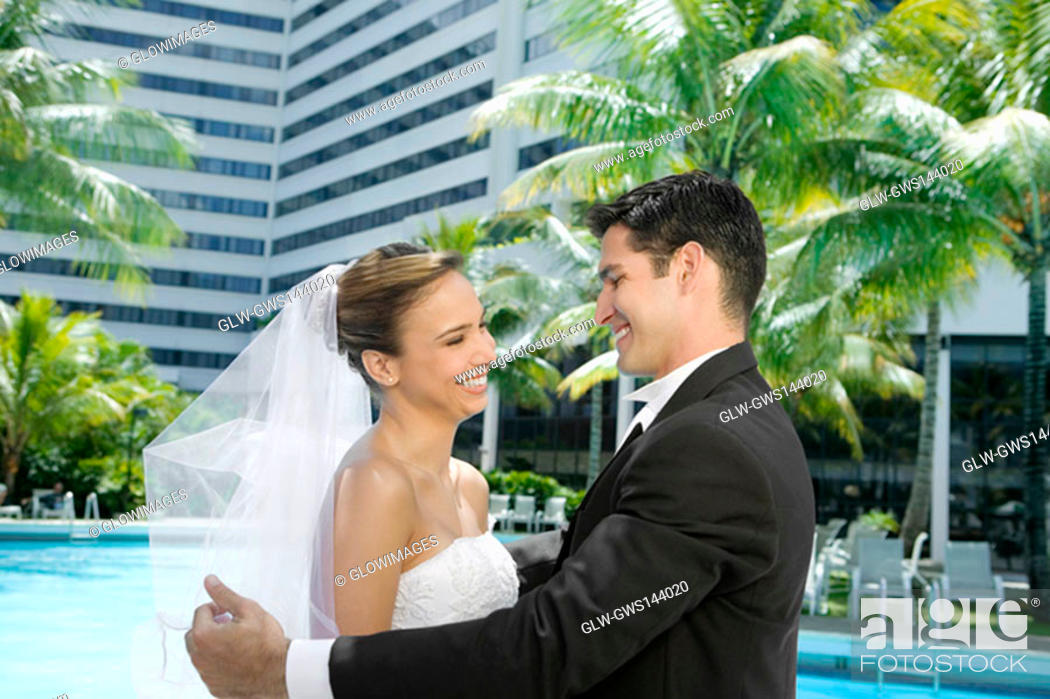 Stock Photo: Side profile of a newlywed couple facing each other.