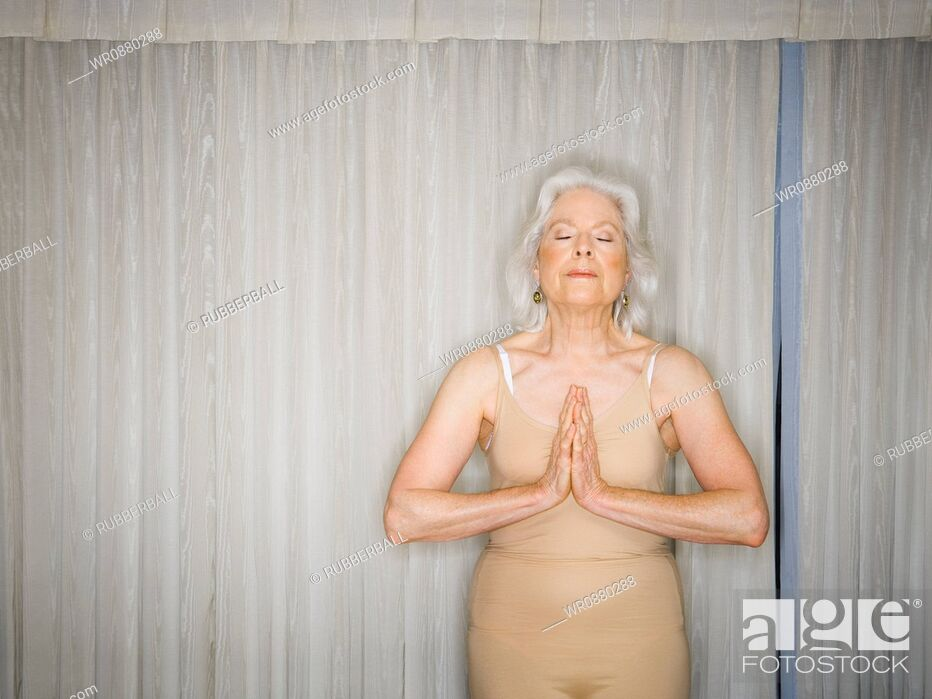 Stock Photo: Senior woman meditating.