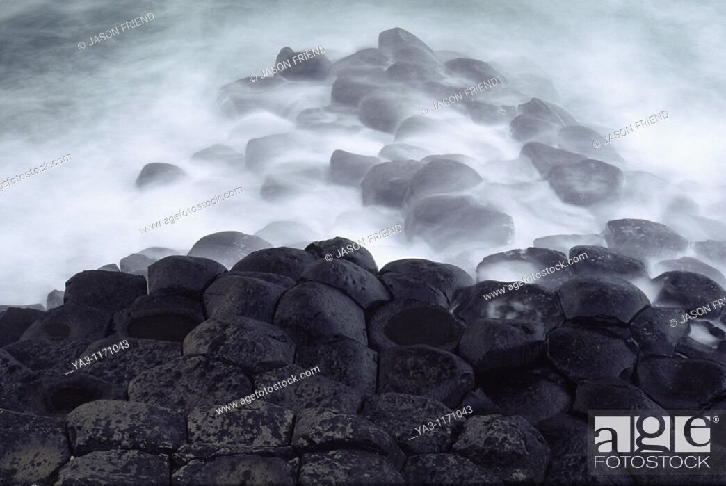 Stock Photo: NORTHERN IRELAND, County Antrim, Giants Causeway  Waves crash against the hexagonal basalts rock formations of this world heritage site.